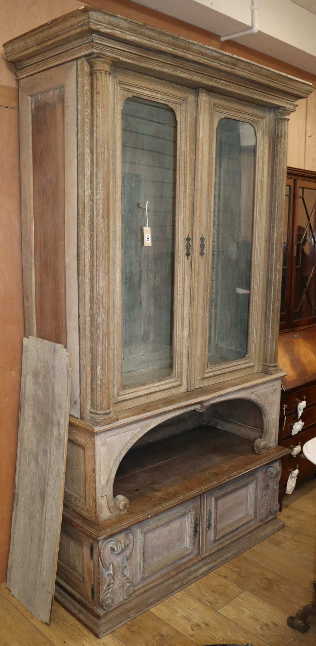 Lot 814 - A late 19th century French limed oak glazed bookcase W.118cm
