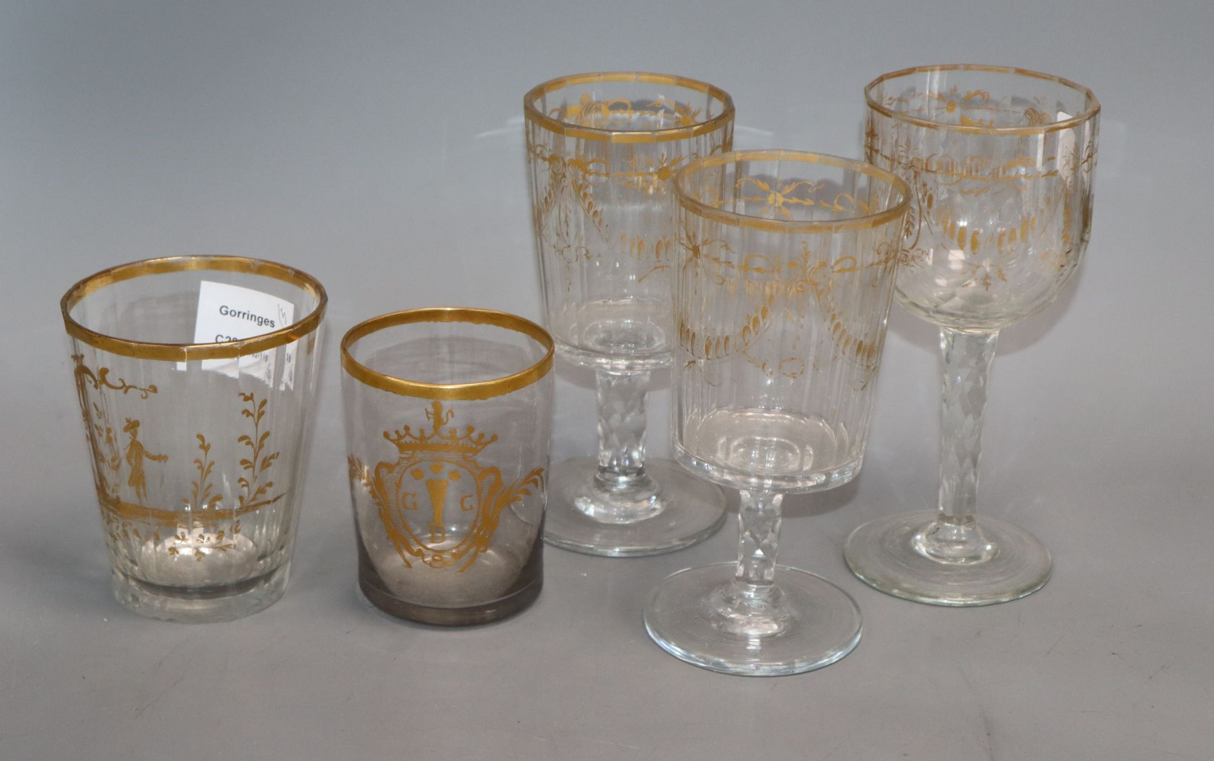 Lot 138 - Three 19th century German gilt glass goblets and a similar tumbler