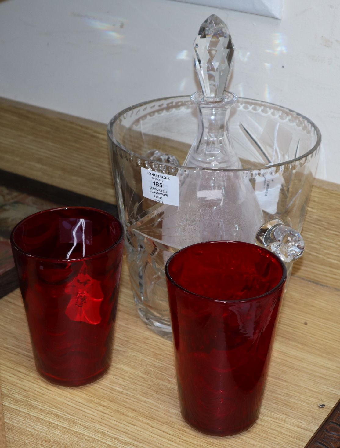 Lot 185 - Two Whitefriars optic design ruby tumbler vases, a heavy lead crystal ice bucket and a cut glass