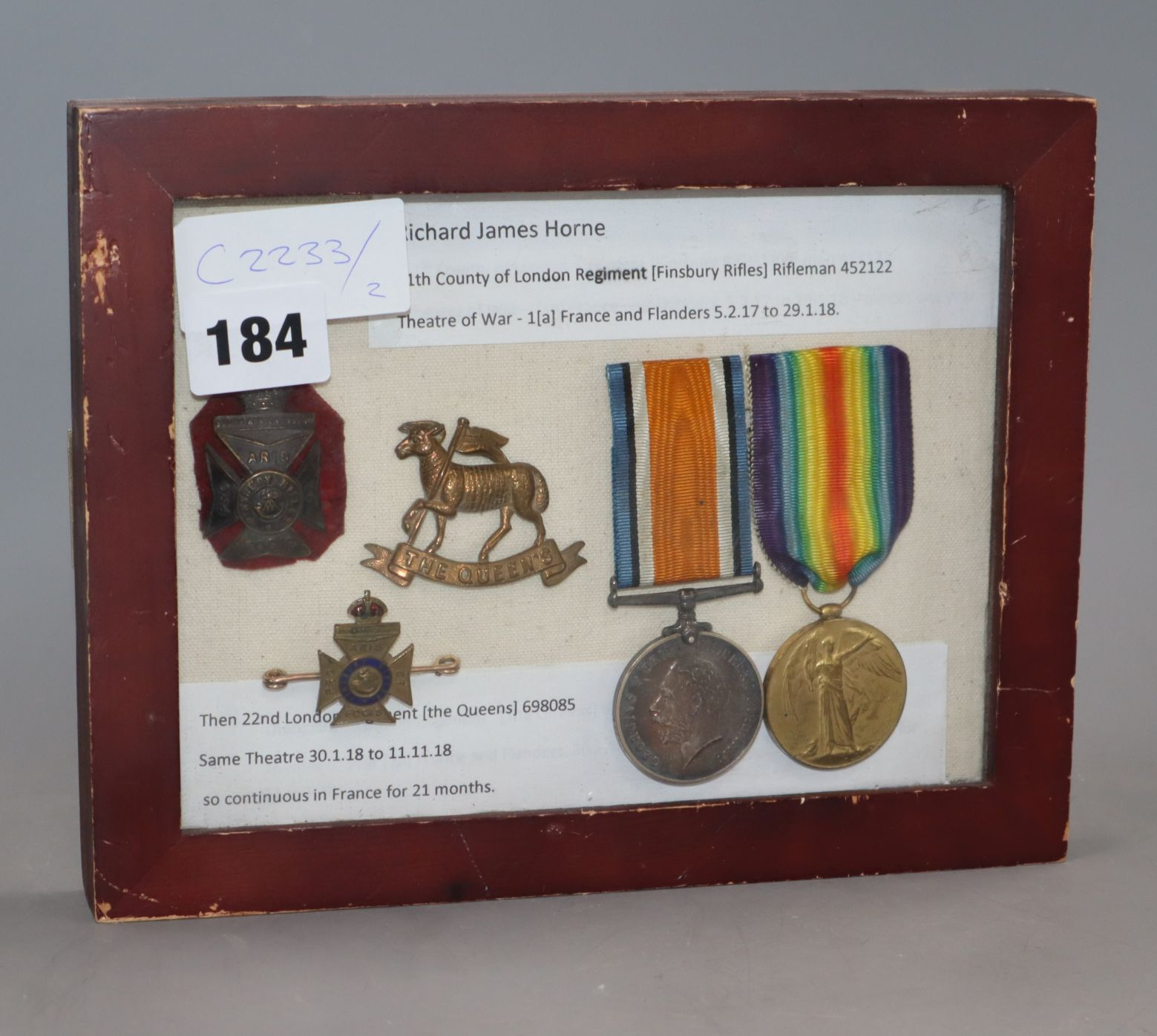 Lot 184 - A set of English World War framed medals (pair) and badges