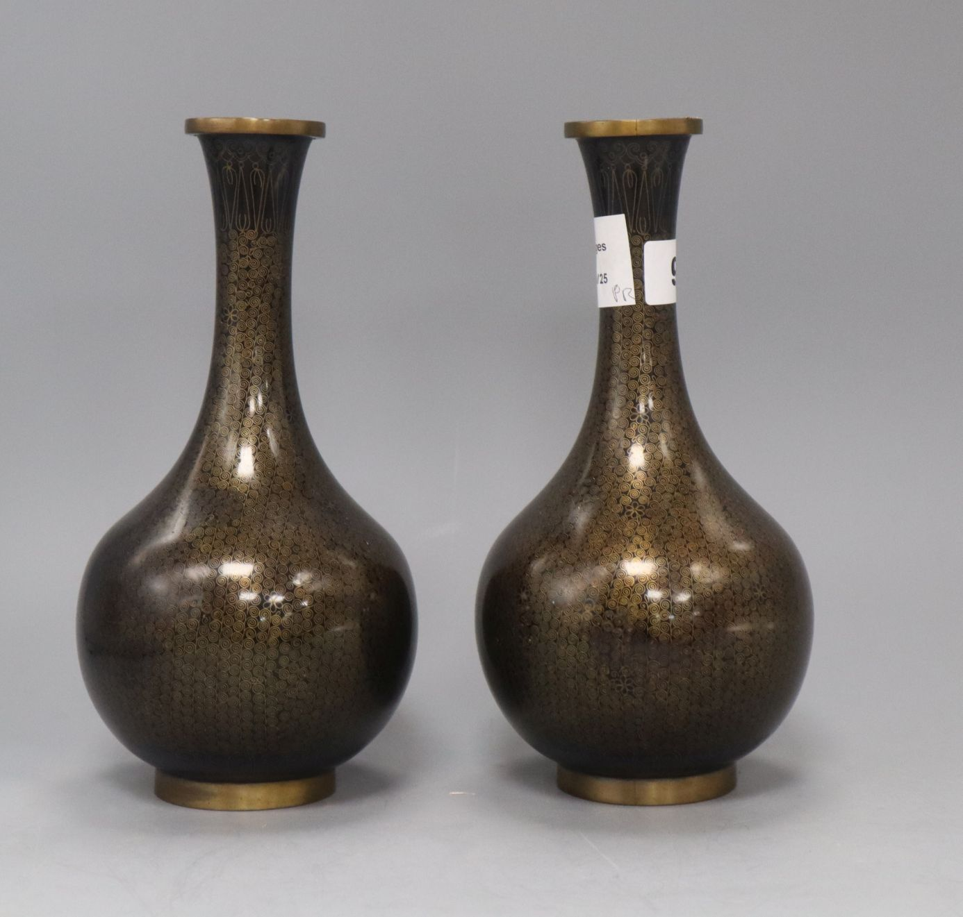 Lot 9 - A pair of Chinese black ground cloisonne enamel bottle vases, mid 20th century height 24cm