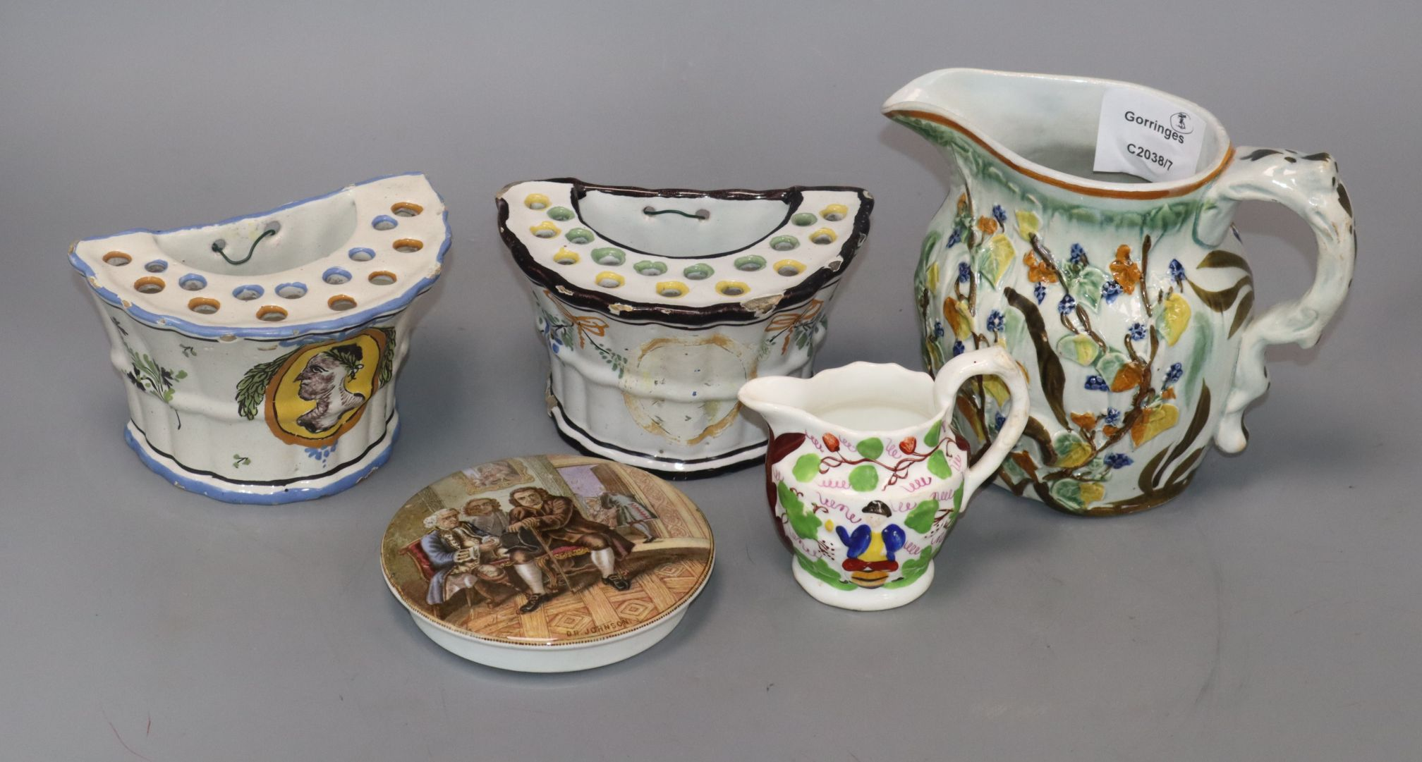 Lot 19 - Two graduated Prattware pottery jugs and a pot lid and two pottery flower vases