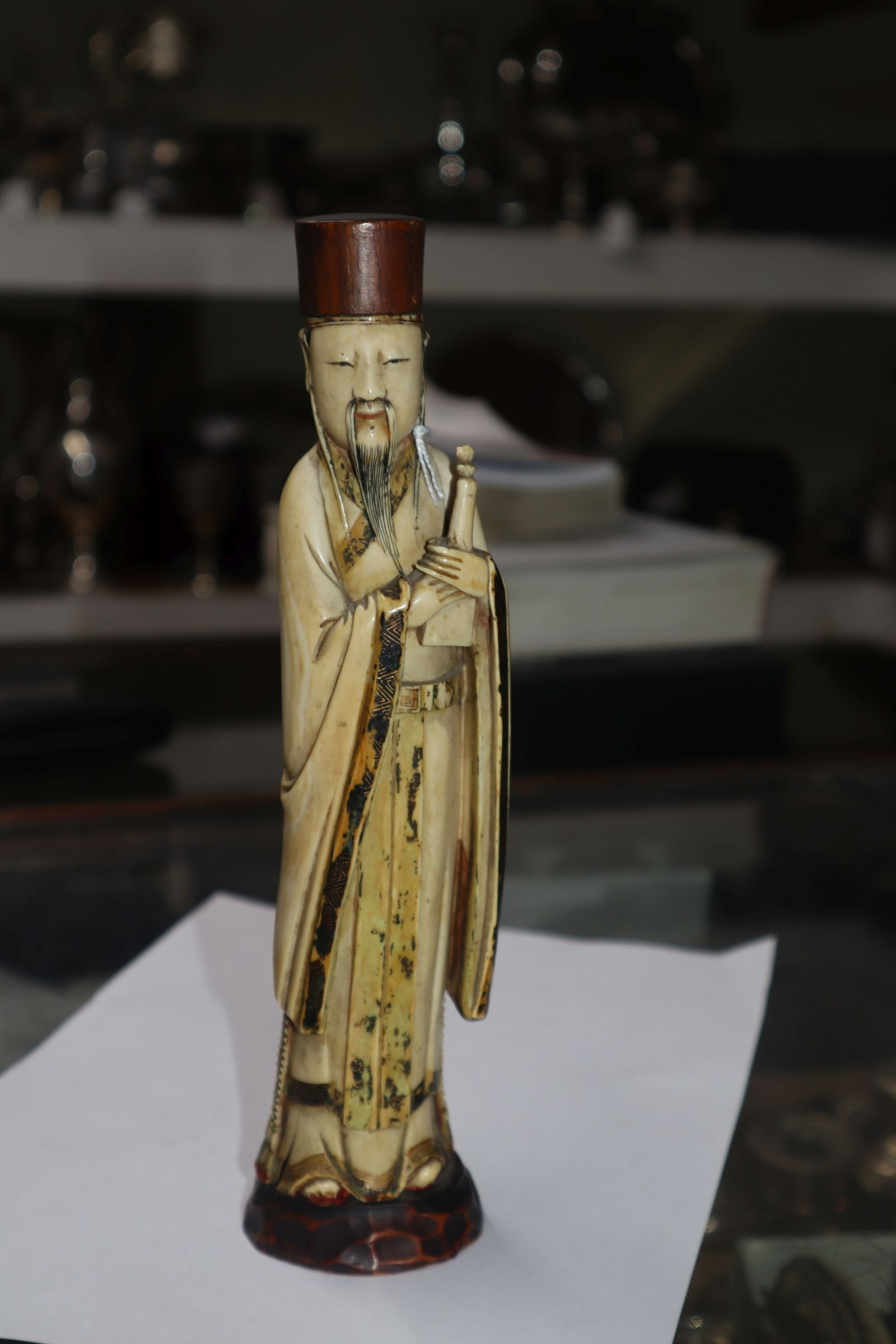 Lot 299 - A Chinese lacquered ivory figure of Lu Dongbu, 19th century
