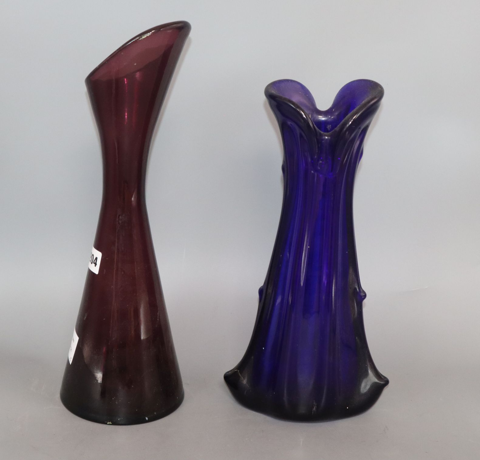 Lot 155 - A 1950's amethyst glass vase and a knobbly blue glass vase height 40cm