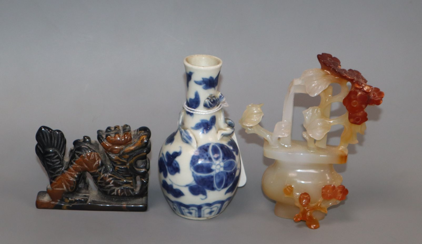 Lot 303 - A small Chinese blue and white vase, a chalcedony basket of flowers and a dragon figure