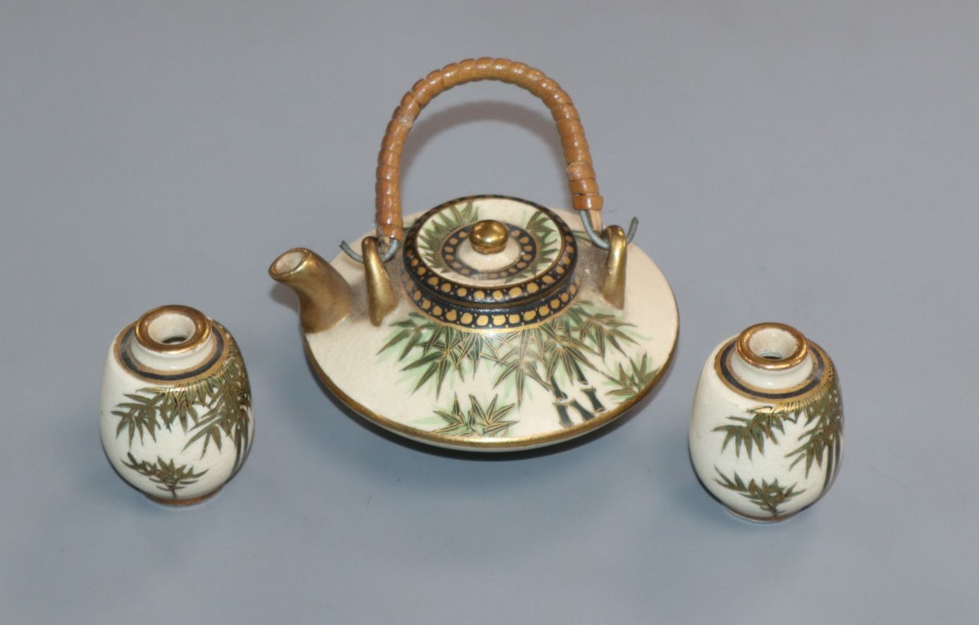 Lot 296 - A Japanese Satsuma pottery miniature tea pot and two vases Provenance - The owner and her family