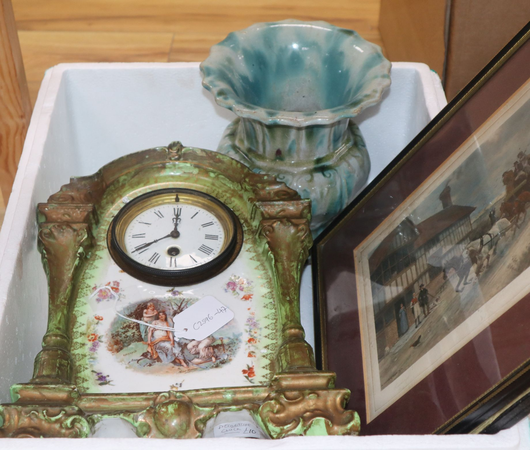 Lot 186 - A pottery painted timepiece, a vase and two prints