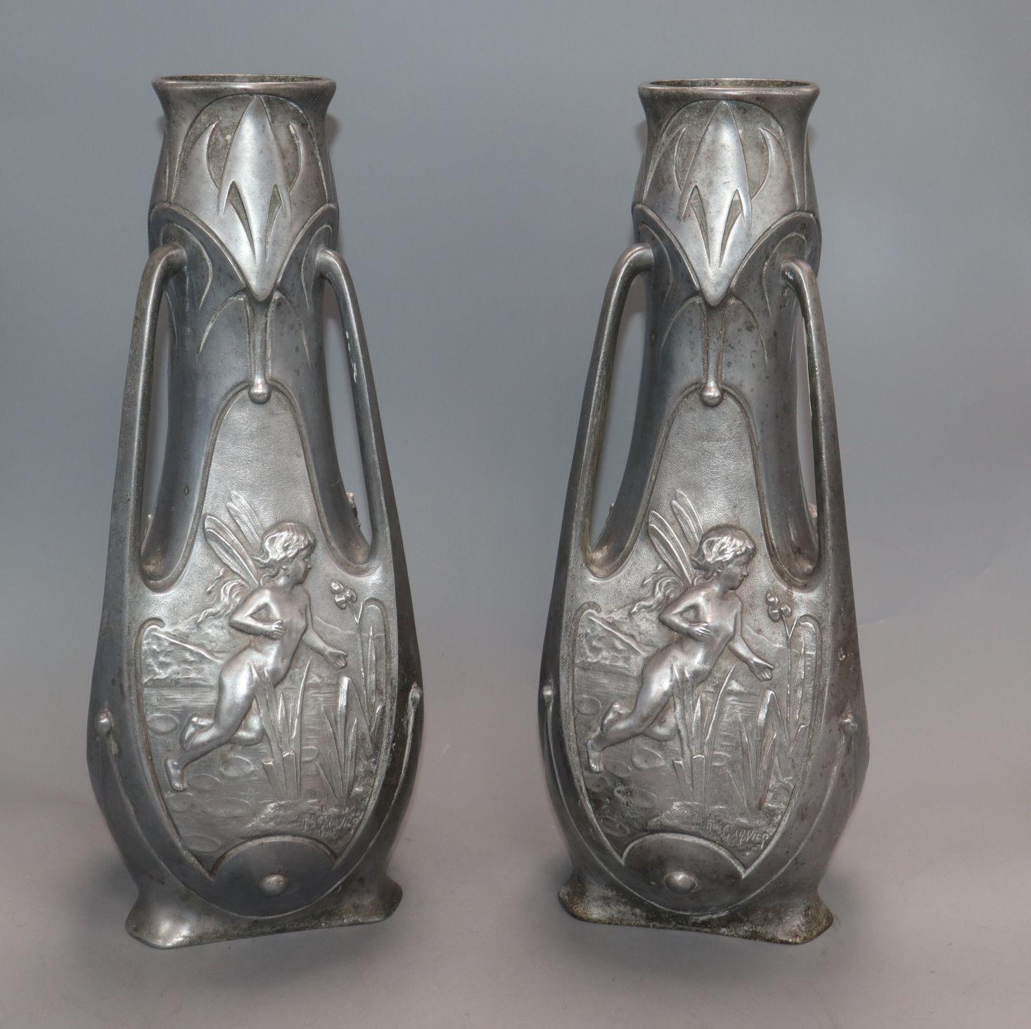 Lot 79 - A pair of pewter Art Nouveau vases, signed J.Garnier height 38cm