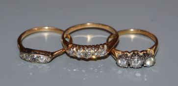 Three assorted early 20th century and later 18ct and diamond set rings, including five stone and