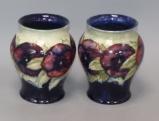 A pair of Moorcroft Pansy vases height 17cm