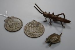 Two bronze pendants - a tortoise and a locust