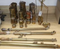 Ten reproduction and miniature brass Davy lamps, four brass garden sprayers and a set of brass