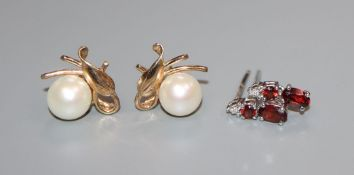 Two pairs of earrings including 14k and cultured pearl and 18ct gold and gem set.