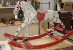 A vintage Stred rocking horse length 107cm