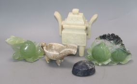 Two Chinese hardstone vessels, two carvings of peaches, and a stone paperweight