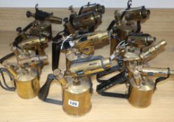 A collection of twelve brass blow torches, various sizes and makers