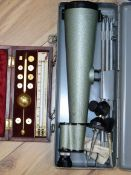 A cased Sykes hydrometer and a cased spotting scope