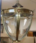 An Edwardian Adam design brass four glass hall lantern, with ram head mounts