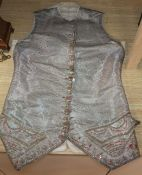 An 18th century gentleman's silver brocade and gold thread embroidered waistcoat