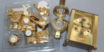 A collection of twelve novelty miniature brass clocks, a modern brass compass by Ross and a quartz