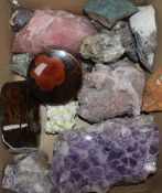 An amethyst geode, a small collection of mineral specimens, including pink quartz and two Japanese