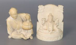 A Japanese ivory figure of a seated man and an Indian ivory figure of a deity