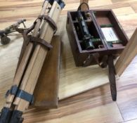 A theodolite and tripod and set of drawing instruments