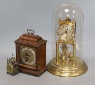 A gilt brass torsion clock under glass dome (a.f), an Elliot mantel clock and a miniature '