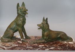 An Art Deco patinated spelter model of two dogs, on marble base length 52cm