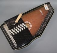 An Ashbury 21 Bar Deluxe Autoharp with tuning wrench