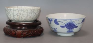 A Chinese crackle glaze bowl, early 20th century blue and white bowl and a wood stand largest