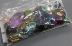 A quantity of assorted unmounted cut paste and gemstones, including amethyst, citrine, opal and