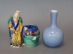 A Chinese blue glazed bottle vase, Kangxi mark but Republic period and a Chinese pottery figure