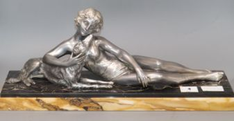 A French Art Deco silvered metal group of a girl with borzoi, after Le Bruns length 55cm
