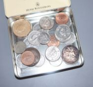 A collection of UK and World currency, including silver proof coins and commemorative crowns