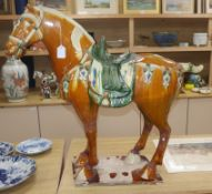 A large Chinese Tang style sancai model of a horse height 80cm
