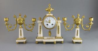 A Louis XVI style white marble and gilt-bronze garniture de cheminee, the portico-style clock with