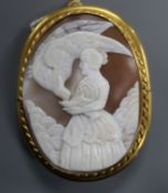 A gilt metal mounted oval cameo pendant brooch, carved with Diana & the Eagle, 65mm.