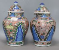 A pair of Chinese porcelain wucai jars and covers, late 19th/early 20th century height 36cm (a.f.)