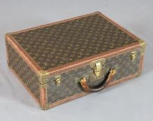A Louis Vuitton suitcase, with brass mounted LV fabric, no.957179, 20 x 14.5 x 7in.