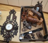 A quantity of assorted Black Forest and other wood carvings