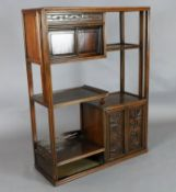 A Chinese hongmu display cabinet, c.1910, with an arrangement of cupboards and a drawer carved in