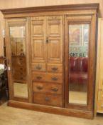 A late Victorian oak triple wardrobe W.193cm
