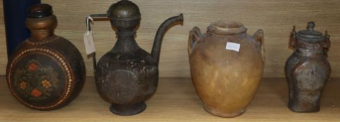 An Indo-Persian brass ewer, a parchment jar, painted metal flask and a tinned metal flask