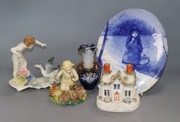 A Doulton 'Blue Children' plaque, miniature vase, two figurines and a Staffordshire burner