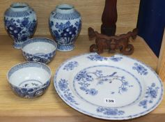 A pair of 18th century Delft blue and white vases, an 18th century Chinese blue and white dish and