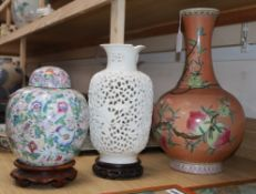 A Chinese peach vase, a reticulated vase and a jar and cover