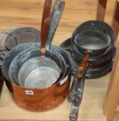 A quantity of copper cooking pans and other metalware including brass and pewter