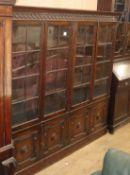 A 1920's oak four door bookcase W.190.5cm