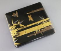 A Japanese lacquer writing box (suzuribako), early 20th century, the cover gold lacquered and